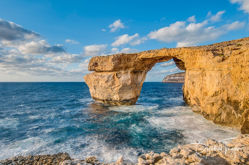Azure Window natural arch featuring a table-like rock over the sea in the Maltese island of Gozo.