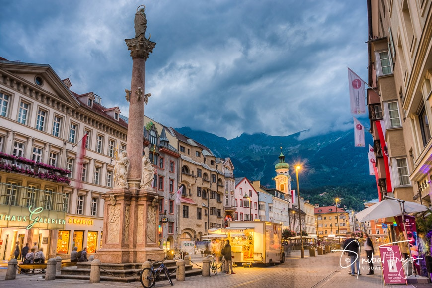 INNSBRUCK, AUSTRIA - AUG 14: St Anne Column (Annasaule) is a statue of the Virgin Mary in Maria-Theresien Street and one of its most famous landmarks on Aug 14, 2013 in Innsbruck, Austria.