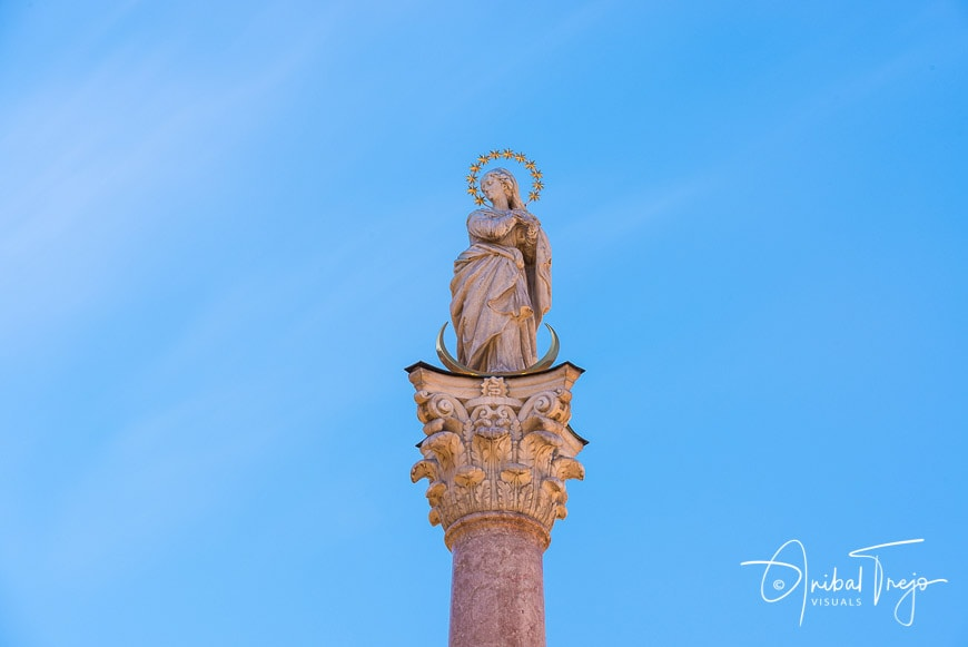 St Anne Column in Maria-Theresien Street, a statue of the Virgin Mary atop a Corinthian red marble column erected in 1706 to celebrate the withdrawal of invading Bavarian armies in Innsbruck, Austria.